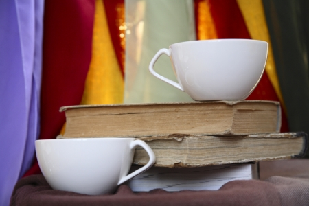 two cups, old books Stock Photo