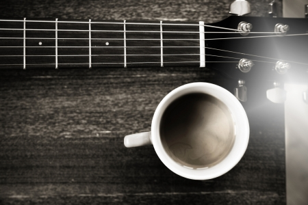 black&white, image of guitar and cup of coffee