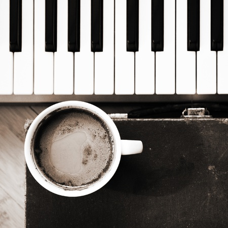 Cup of coffee and piano