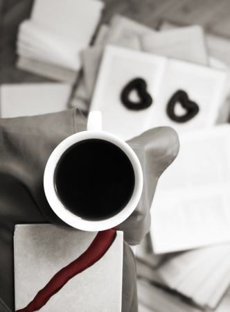 monochrome image, cup of black coffee, heart-symbols photo