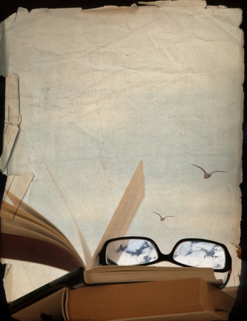 vintage background, books and glasses, dreaming of the vacation Stock Photo