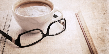 artwork  in vintage  style,  textbook, glasses and cup of coffee Stock Photo