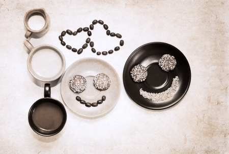 artwork  in grunge style,  two cups of coffee, milk jug,  heart shapes of coffee beans and smiles made of coffee beans and cookies