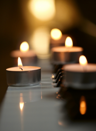 burning candles and pianoforte Stock Photo