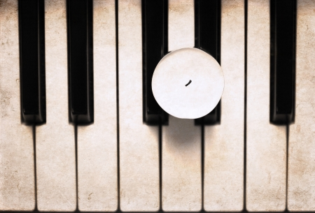 artwork  in grunge style,  candle on the piano photo