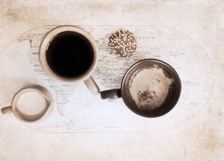 artwork  in grunge style,  two cups of coffee, world political map, milk jug and cookie photo