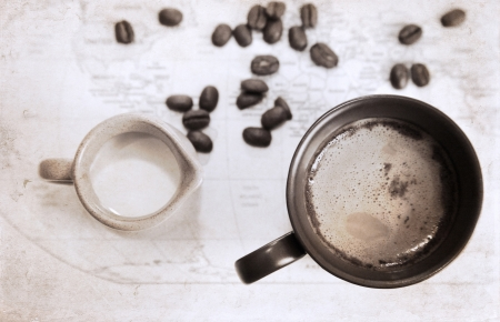artwork  in grunge style,  two cups of coffee, milk jug, coffee beans, world political map photo