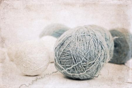 artwork  in grunge style,  balls of wool