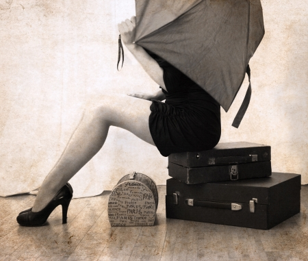artwork  in vintage style,  beautiful woman waiting with luggage