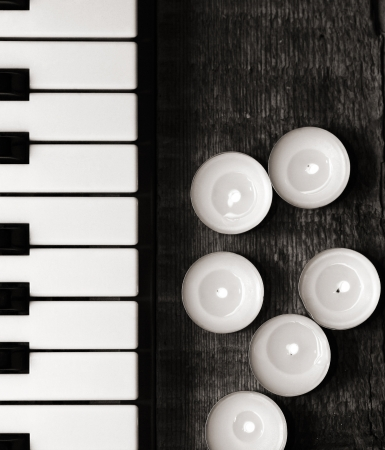 monochrome image, burning candles and pianoforte photo