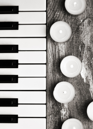 Toned image, burning candles and pianoforte photo