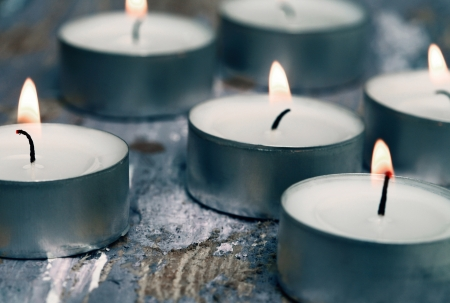 Toned in cold colors image, candles photo