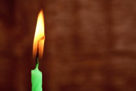 colores calidos: Imagen en tonos de colores c�lidos, vela encendida Foto de archivo