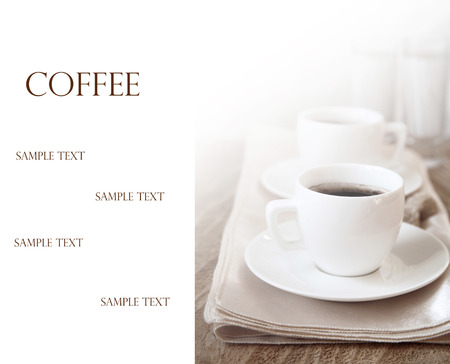Toned image, Two cups of dark coffee, white with sample text photo