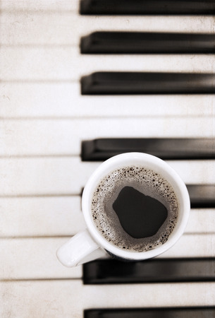Artwork  in painting  style,  cup of coffee, piano photo