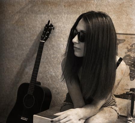 Artwork in retro style, beautiful woman, guitar
