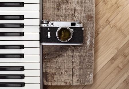Artwork in retro style, old camera,  piano