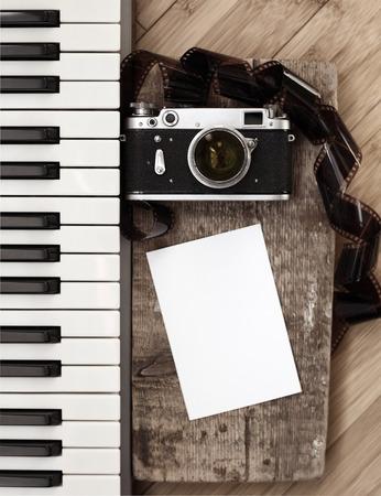 pianoforte: Artwork in retro style, old camera, film, piano