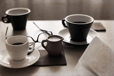 Artwork in retro style,  cups of coffee, glasses, milk