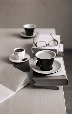Artwork in retro style,  cup of coffee, glasses, notebook, books Stock Photo