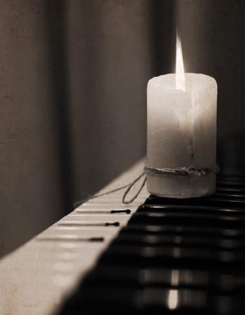 pianoforte: Monochrome image, spent candle, piano