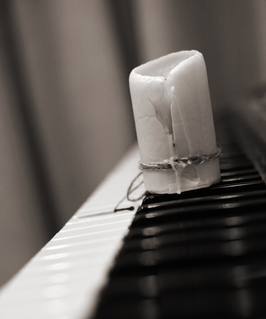 spent: Monochrome image, spent candle, piano