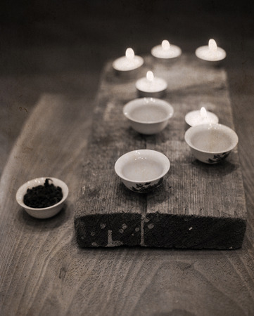 Artwork in vintage style, china tea,  candles Stock Photo