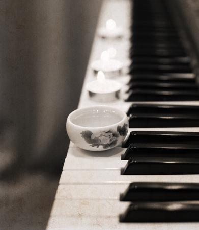Artwork in vintage style, china tea, piano, candles