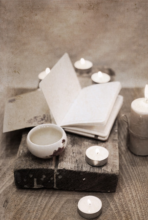 Artwork in vintage style, china tea, notebook, candles Stock Photo