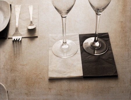 Artwork in retro style,  in  restaurant, two glasses of wine, table