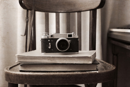 Artwork in retro style,  photo-camera, books