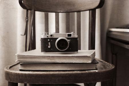 Artwork in retro style,  photo-camera, books