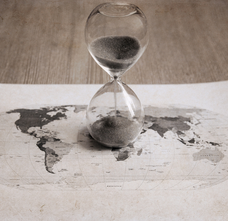 Artwork in retro style, sandglass, political map of the world, time passing Archivio Fotografico