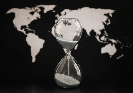 Artwork in retro style,  sandglass, world political map, time passing