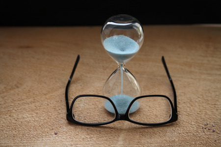 Time running out, sandglass, glasses Archivio Fotografico