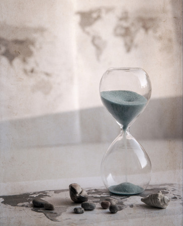 Preparation for the vacation, time is running out, world map, sand glass, sea shells