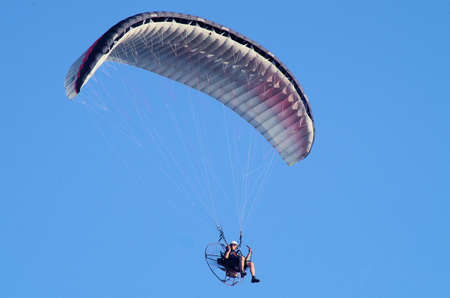 clear view of a paraglider in the sky