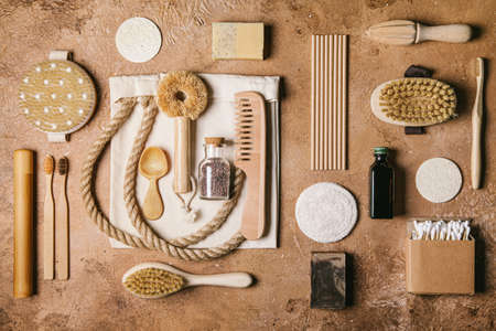 Zero waste concept. Flat lay of eco friendly bathroom and kitchen accessories on a beige background. Eco friendly and reuse concept.