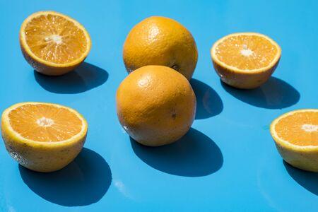 oranges and lemons on a light blue background Stock fotó