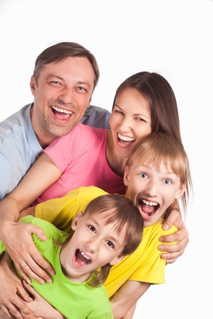 happy family of a four smiling on white Stock Photo - 13777316