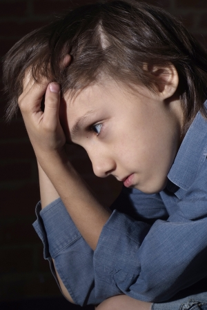 Caucasian child frustrated sitting photo