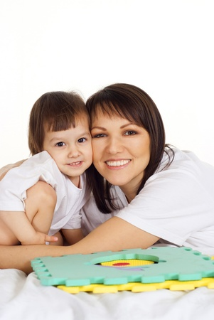 mama: A beautiful Caucasian miss with his mama on the bed Stock Photo