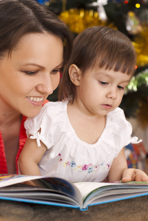 decided: Caring mother decided to read to her child an interesting book on Christmas Eve