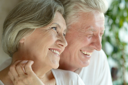 grandparents family: Close-up portrait of a happy senior couple at home