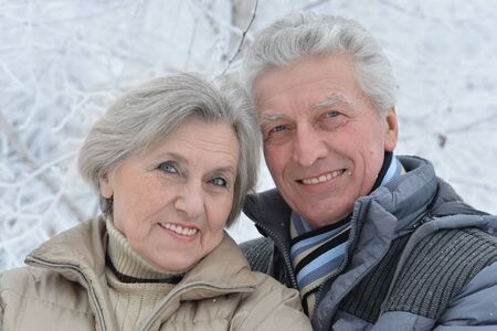 couple winter: Happy senior couple walking in winter outdoors Stock Photo