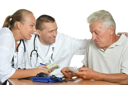 Old man talking with two doctors Stock Photo