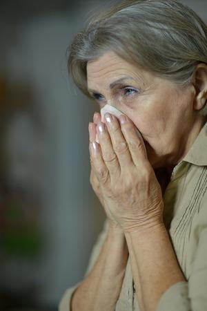 handkerchief: Close-up of ill elderly woman with handkerchief
