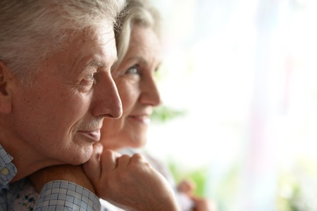 healthy llifestyle: Close-up portrait of a happy senior couple at home