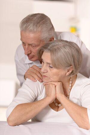 lamentable: Close-up portrait of an elder couple at home
