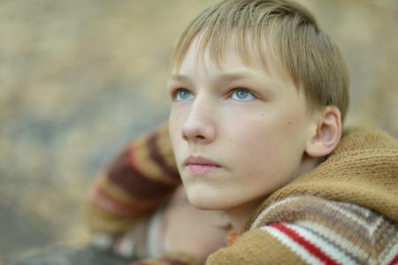 lamentable: Portrait of a sad little boy outdoors in autumn Stock Photo
